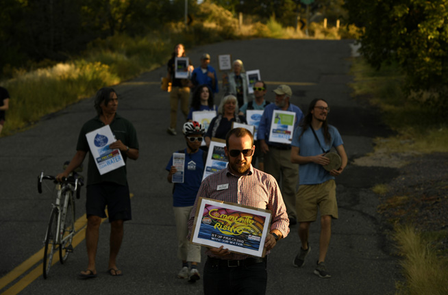DENVER, CO - SEPTEMBER 23: Nick Thomas, who is running for Colorado's 2nd congressional district as an independent candidate, joined with other activists taking part in a rally and march to support Proposition 112 on September 23, 2018 in Denver, Colorado. The group rallied at Inspiration Point, across from Willis Case Golf Course, and then marched, with their signs chanting against fracking, to the home of former Secretary of the Interior Ken Salazar who lives in the area. The activists, who support the ballot measure that calls for oil and gas setbacks of 2500 feet from homes and schools, were protesting a Democratic party fundraiser held by Salazar for gubernatorial candidate Jared Polis. The group said they are picketing Polis because he does not support the measure. (Photo by Helen H. Richardson/The Denver Post)